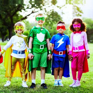 four cute little kids wearing super hero costumes