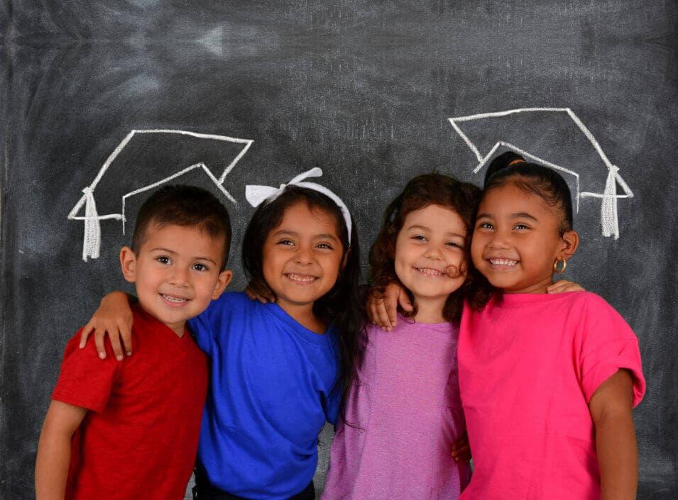 four cute kids smiling