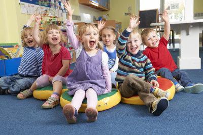 group of children raising their hands